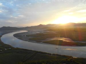 Zonsondergang bij de Baai van Suncheon (순천만).